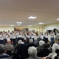 Un giorno di allegria all'Oasi di Nazareth: cantano gli alunni della De Gasperi